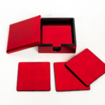 Red metallic wooden lacquer coaster set with matching box with lid.